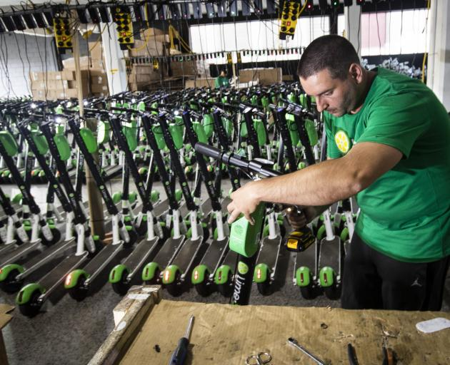 Mechanic Vlatko Jovanovski repairs Lime scooters in storage at Lime's warehouse in Kingsland, Auckland, this week. Photo: NZME