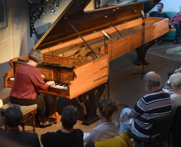 Belgium-based concert pianist Catherine Geels performs at the Alexander Pianos showroom in...