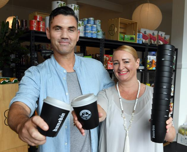Nick Maguire, of the Kind Grocer, and Steph Fry, of IdealCup, show the first of the cups to be launched in Dunedin as part of the CupCycling initiative. Photo: Stephen Jaquiery