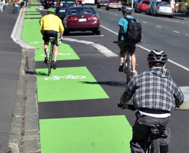 Cyclists use the new southbound cycleway on Cumberland St yesterday afternoon. PHOTO: PETER...