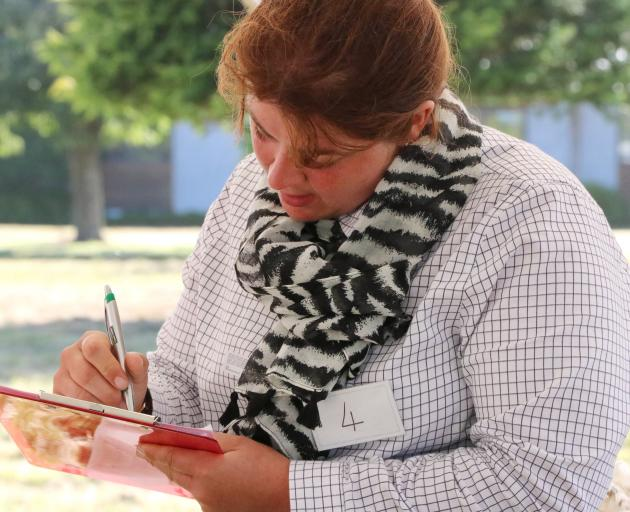 Elizabeth Graham, of Hindon, competes in the New Zealand Young Farmers national stock-judging...