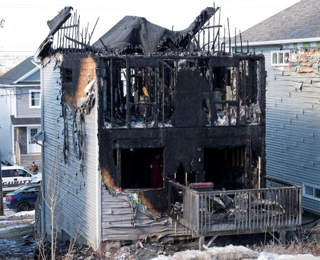 A house where an early morning fatal fire killed seven children from the same family in the community of Spryfield is seen in Halifax. Photo: Reuters