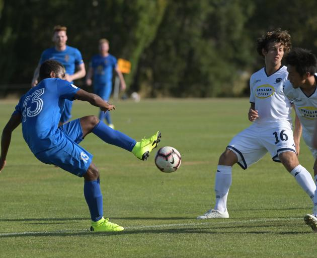 Southern United forward Azariah Soromon executes a pass during a National Football Premiership match at Sunnyvale last night, while Auckland City players Yousif Ali and Takuya Iwata try to intercept it. Photo: Linda Robertson