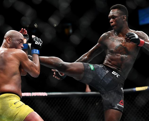 Israel Adesanya in action against Brazilian Anderson Silva in Melbourne today. Photo: Getty Images