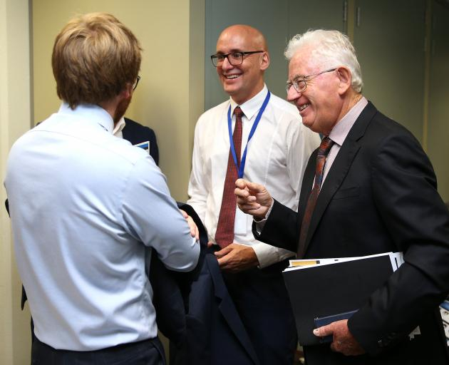 Tax Working Group chairman Sir Michael Cullen (right) shares a lighter moment with colleagues...