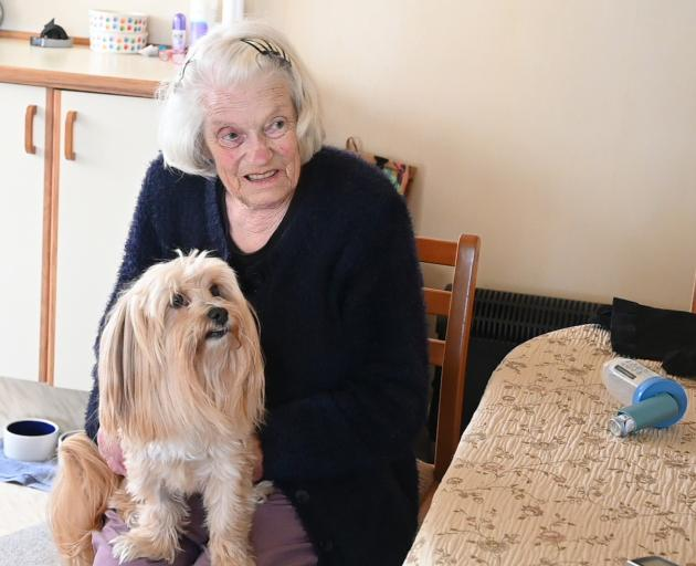 Care at home means Gwen Robertson (75), with her dog Leroy, gets to stay longer in her flat while...