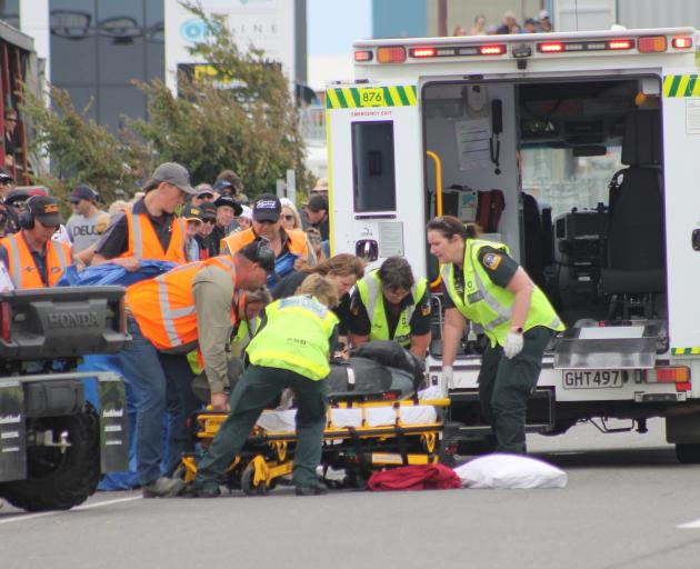 Tony Campbell is put into an ambulance. Photo: Southland Express