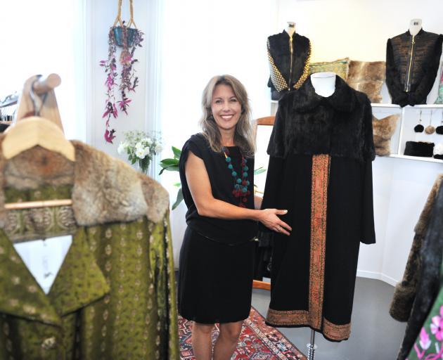 Dunedin designer Jane Avery and the bespoke coats in her lower Stuart St studio. Photo: Christine O'Connor