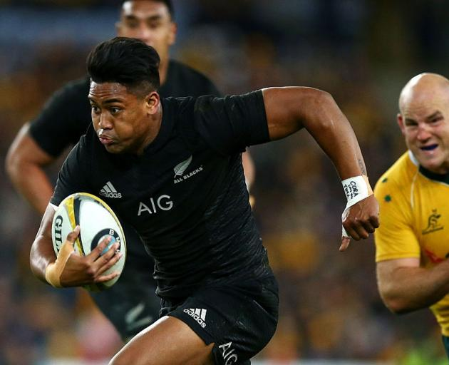 Julian Savea runs with the ball against Australia. Photo: Getty Images