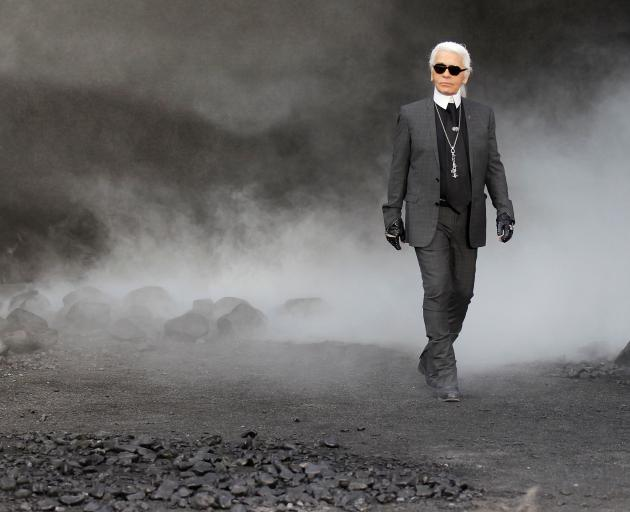 German designer Lagerfeld appears at the end of his Fall-Winter 2011/2012 show for Chanel during Paris Fashion Week. Photo: Reuters