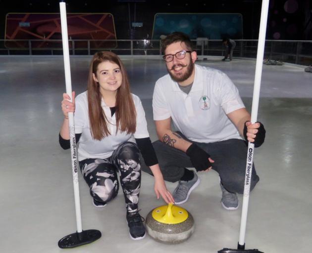 Kathryn Henry and William Heron in Kingdom Curling Association shirts. Photo: Deborah Heron