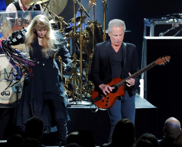 Former Fleetwood Mac guitarist Lindsey Buckingham underwent emergency open heart surgery last week that damaged his vocal cords, his wife said. Photo: Reuters