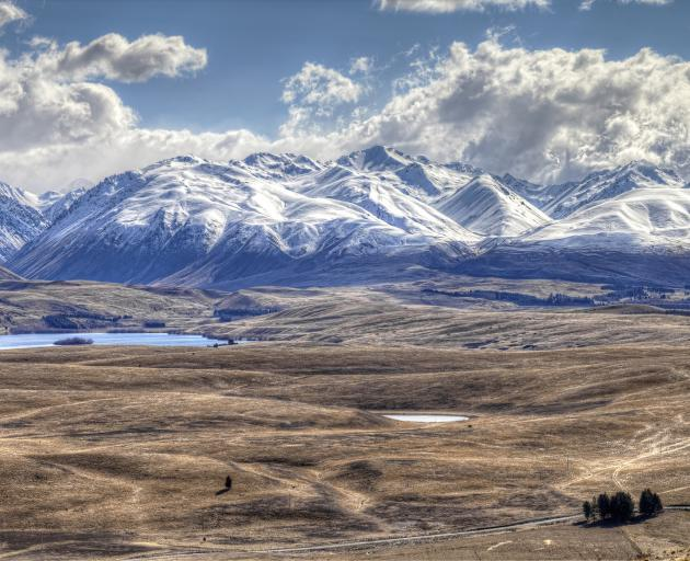 Looking over Mackenzie basin to the Southern Alps located in the South Island, New Zealand. Photo: Getty Images