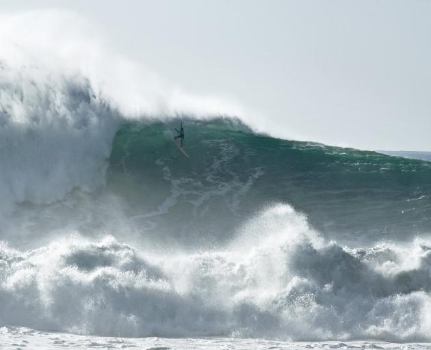 "The death-defying surf at Nazare's ""praia do norte"", though this is a mere 12m wave. Photo: Getty..."