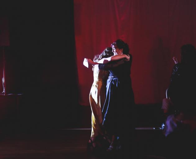 Otago Southland Theatre Awards host Lily Stock (left), of Oamaru, congratulates Krissy McGeown,...
