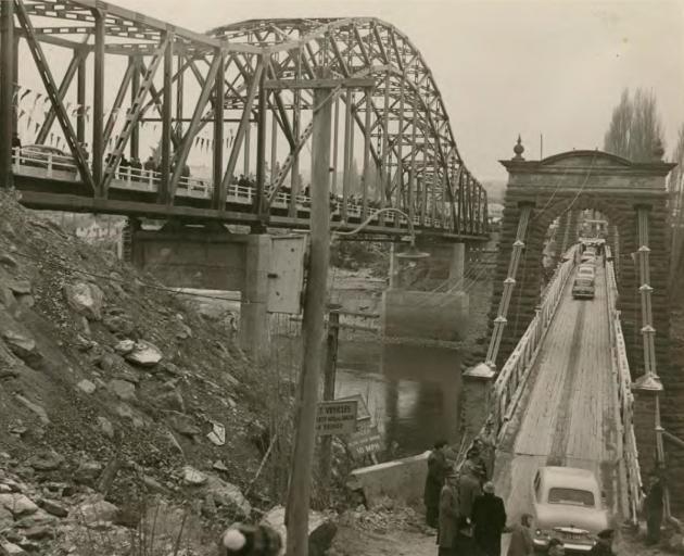 "Alexandra's new ""blue"" bridge is opened on July 5, 1958, alongside the original bridge, which..."