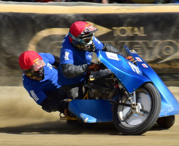Grant Lightfoot and Phil Rooney, of Invercargill, speed to a win in a sidecar race at Oreti Park...