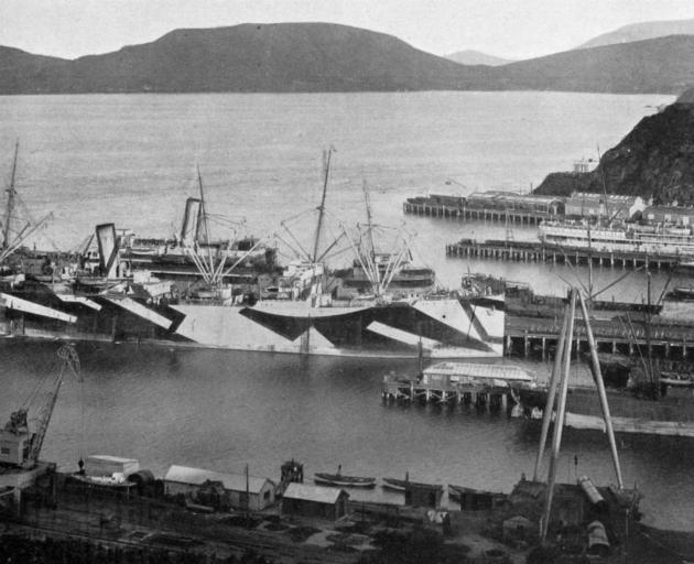 Port Chalmers resuming something like its pre-war shipping activity. The camouflaged steamer at...