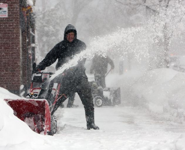 Man clears snow during a winter storm in Buffalo, New York. Photo: Reuters