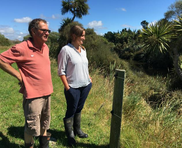 Peter Bonifacio and Rosemary Bird check out some of the native regeneration behind a fence wired to keep stock out. Photos: Chris Tobin