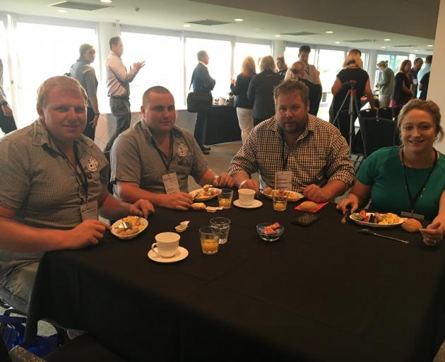 Sam Cooper (left) and Jeremy Madeley, of the Waimak Young Farmers Club (YFC), enjoy some breakfast while networking with Jason de Boo and Megan Hands, of the Dunsandel YFC, at the New Zealand Young Farmers national conference in Christchurch on Friday, Fe