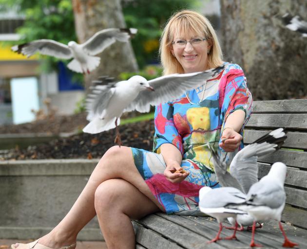 Dunedin resident Sophie Barker with threatened red-billed gulls, in Dunedin's Octagon. Photo: Stephen Jaquiery