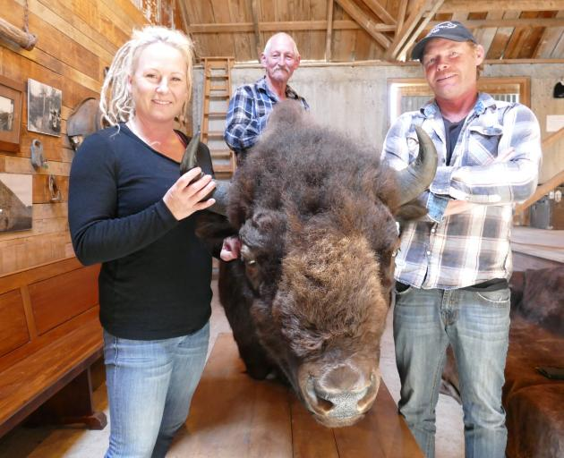 Nadia and Blair Wisely with Bobo the bison, their original sire. In the background is Bobo's breeder Dennis Greenland. Photo: Ken Muir
