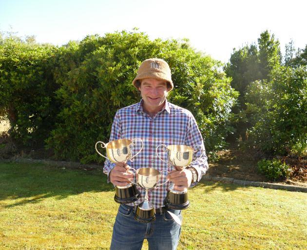 Blair Robertson displays his Romney trophies. Photos: Ken Muir