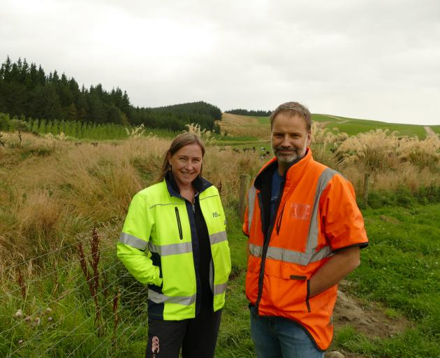 AB Lime environmental manager Fiona Smith with general manager Steve Smith in front of one of the parts of the farm being rehabilitated and set aside for conservation purposes. Photo: Ken Muir