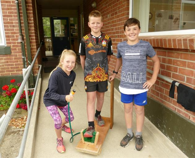 Meg Howard shows off her boot cleaner with Ben Cairns (centre) and Alfie Cowie (all 10). Photos: Ken Muir