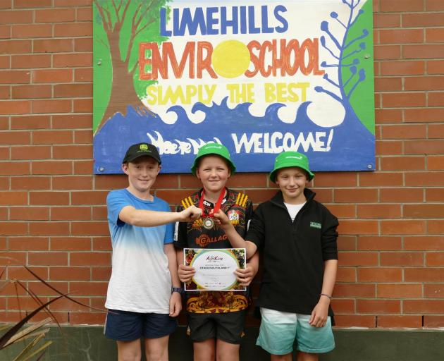 Limehills School pupils (from left) Cooper Mitchell (11), Ben Cairns (10), and Danny McDonald (11) show off their certificate and medal from their win in the AgriKidsNZ Regional Finals at Milton.