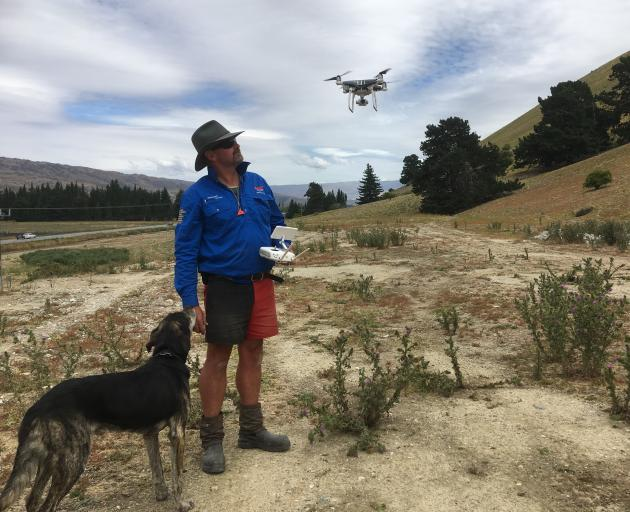 Tony Buchanan, of Bannockburn, with his dog, Wolf,  often muster Central Otago hills with the help of a drone.  The  Lowburn Collie Club even added a drone component to its recent dog trials. Photo: Alexia Johnston
