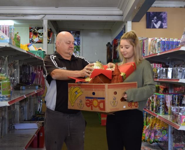 Mosgiel $2 & More co-owner Phil Tate, of Abbotsford, and shop assistant Cherish Thom, of Kinmont,...