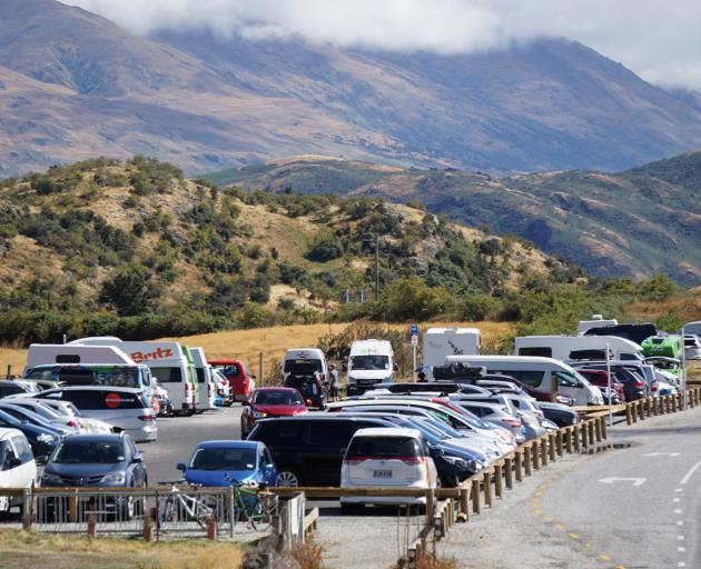 The Roys Peak track car park was at capacity well before lunchtime on Tuesday. Photo: Sean Nugent
