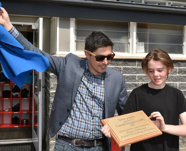 Green MP Gareth Highes and Waitati School student Quince Field at the opening of the Waitati...
