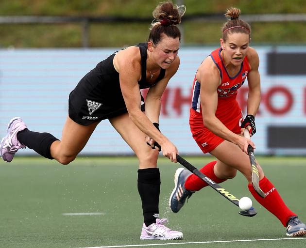 New Zealand's Kelsey Smith (left) plays the ball under pressure from Alyssa Manley of the United...