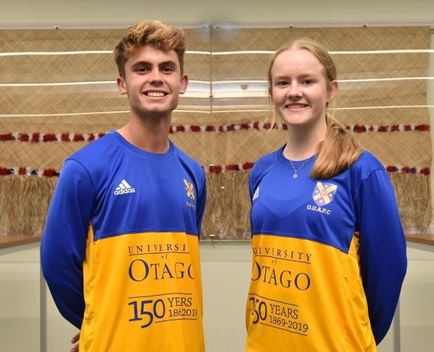 University of Otago Football Club players Oban Hawkins and Erin Roxburgh show off the 150th anniversary strip at a function yesterday to mark the season opening. Photo: Gregor Richardson