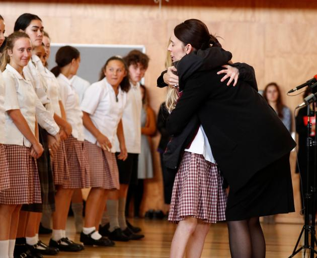 Prime Minister Jacinda Ardern hugs a pupil during her visit to Cashmere High School in Christchurch yesterday