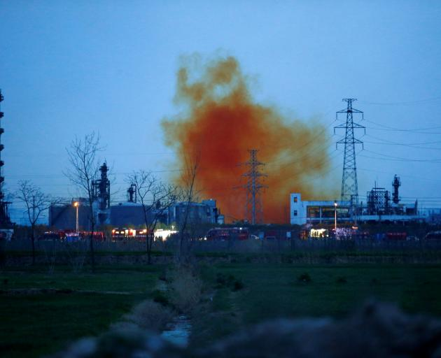 Smoke billows from the pesticide plant owned by Tianjiayi Chemical following an explosion, in...