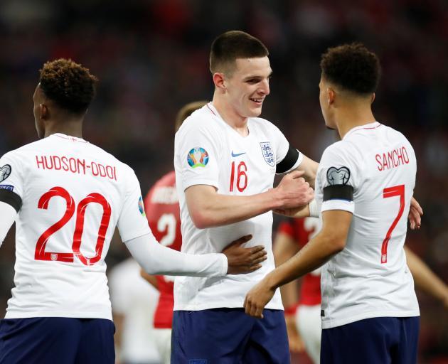England debutantes Callum Hudson-Odoi (left) and Decland Rice (centre), celebrate with fellow...