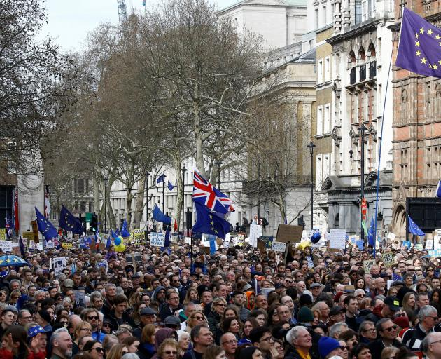 EU supporters, calling on the government to give Britons a vote on the final Brexit deal,...