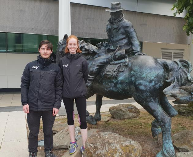 Hunter Burke and Ella Cox at Dunedin Airport upon their arrival home after spending the summer luging in Europe. Photo: Supplied