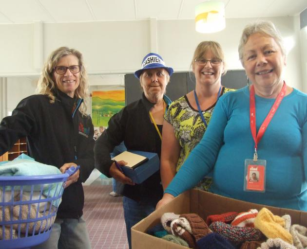 Stand Children's Services staff members (from left) Paula Hutton, Judy Dunick, Timea Welsh and...