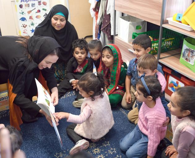Jacinda Adern reads  The Very Hungry Caterpillar to children at the Au-Nur Child Education and Care Centre in South Dunedin. Photo: Stephen Jaquiery