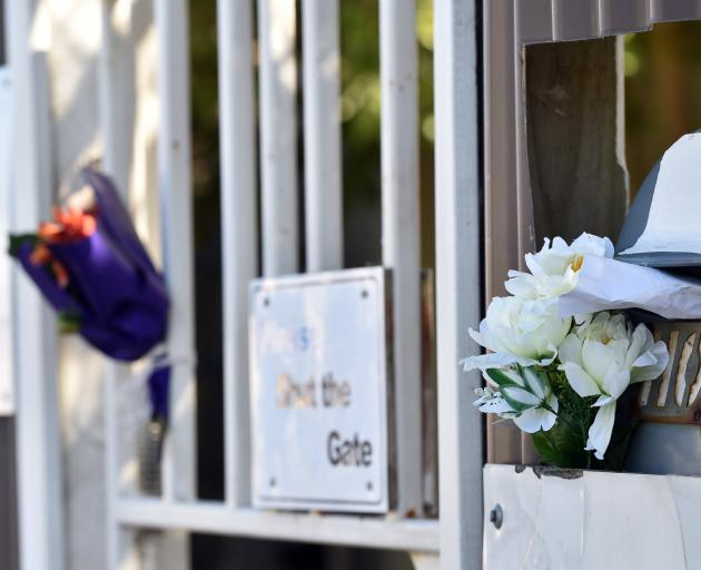 Flowers outside the An-Nur Early Childhood Education and Care Centre Dunedin, which was closed all week after very few Muslim children attended as they were fearful following the Christchurch attacks on Friday. Photo: Peter McIntosh