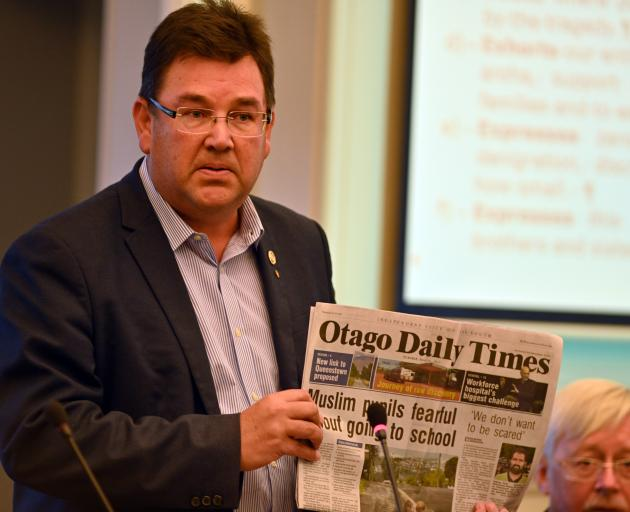 Dunedin councillor Andrew Whiley holds up an 'Otago Daily Times' front page featuring stories on the effect of the Christchurch mosque attacks. Photo: Chris O'ConnorDunedin councillor Andrew Whiley holds up an 'Otago Daily Times' front page featuring stor