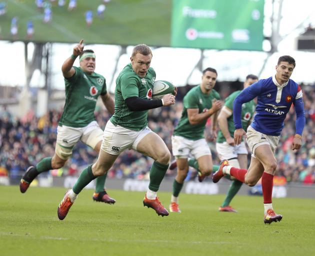 Ireland's Keith Earls breaks through to score a try against France during their Six Nations rugby union international match between Ireland and France at the Aviva Stadium in  Dublin, Ireland. Photo: AP