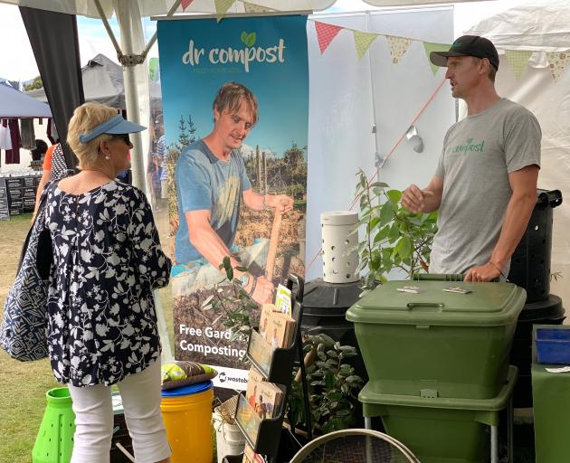 Have you read ALL the instructions?  Ben Elms gives composting advice to Ann Fowler at the Wanaka A&P Show. Photo: Tessa Payze