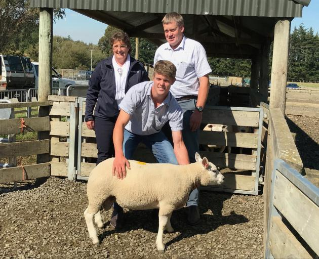 Michael Robinson holds the Beltex ram lamb for which he and his parents Ann-Maree and Brent paid $21,000. Photo: Supplied