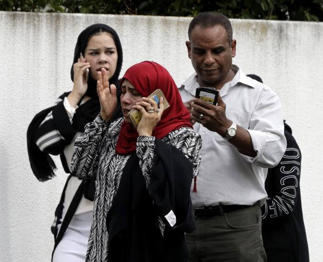 Christchurch residents react in horror to news of Friday's shootings. Photo: AP
